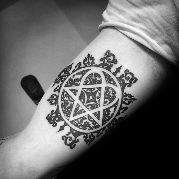 Inner Arm Heartagram Bicep Male Tattoos With Negative Space Pattern Designs