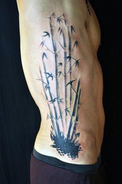 Abstract Bamboo With Flying Bird Leaves Mens Ribs Tattoo