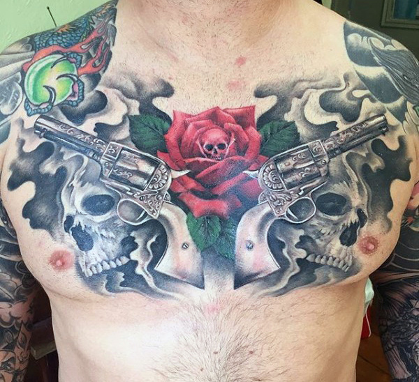 Hombres's Tattoos Of Gun And Rose On Chest