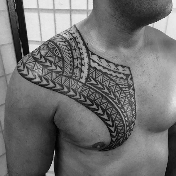 Gentleman With Unique Polynesian Tribal Tattoo On Upper Chest