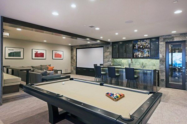 Upscale Mens Home Game Room With Movie Theatre Design
