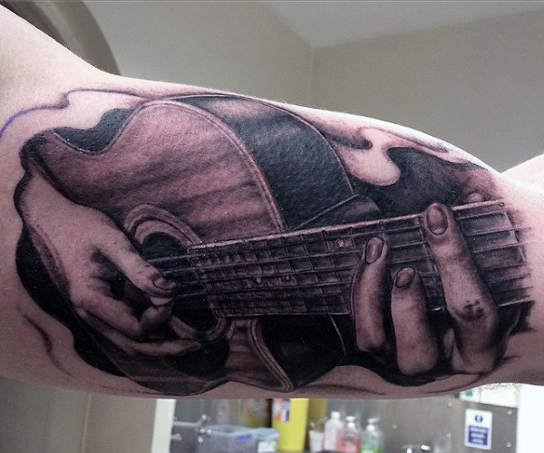 Hommes's Guitar Pick Tattoo