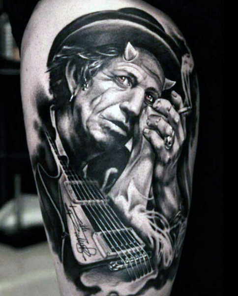 Hommes's Guitar Tattoo