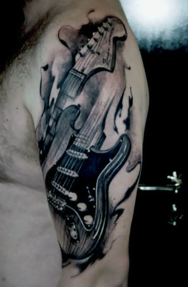 Hommes's Tribal Guitar Tattoo