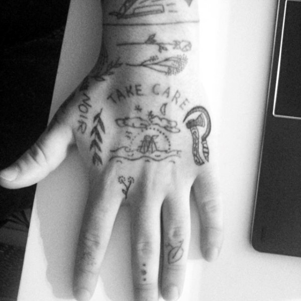 Male With Cool Simple Hand Tattoo Design