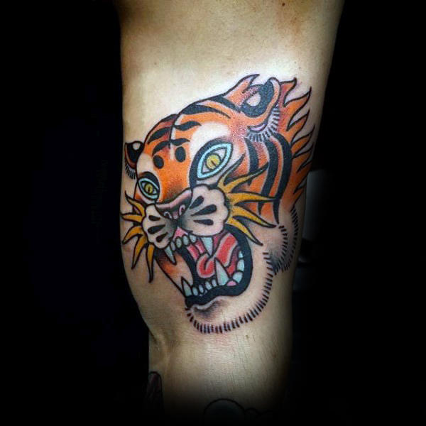 Orange Growling Traditional Tattoo Of Tiger On Guys Arm