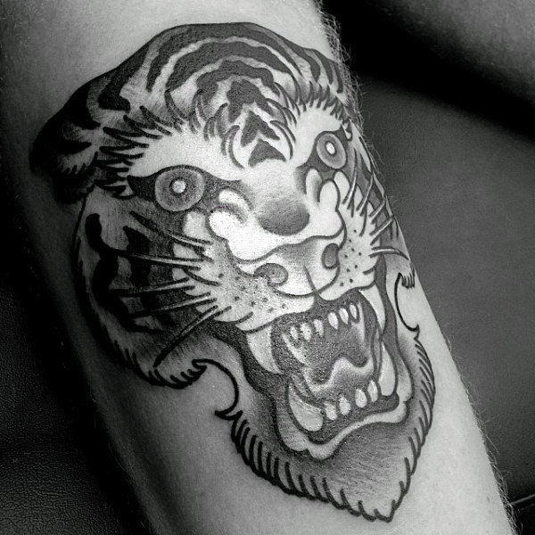 Shaded Black And Grey Tattoo Of Tiger On Man With Traditional Design