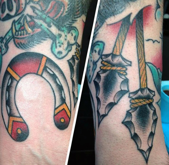 Mens Dangling Pair Of Arrowheads Tattoo On Calves