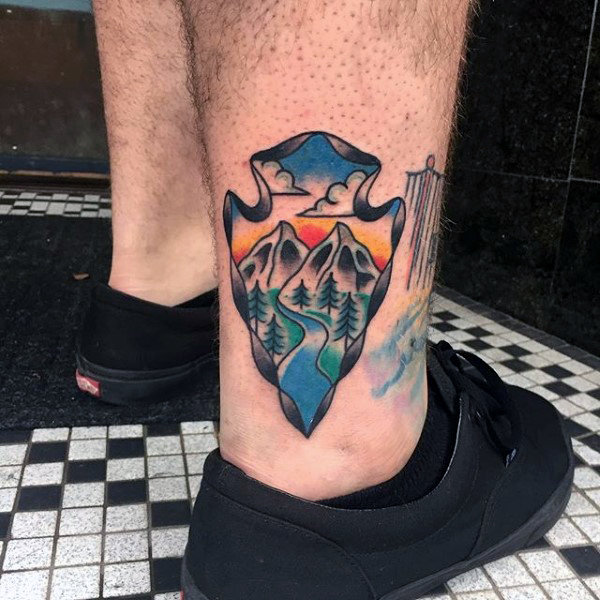 Pretty Stream Flowing Between A Valley Arrowhead Tattoo On Ankles For Guys