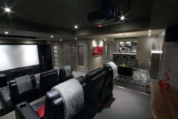 Attached Bar Home Theater In Basement With Black Leather Movie Seating