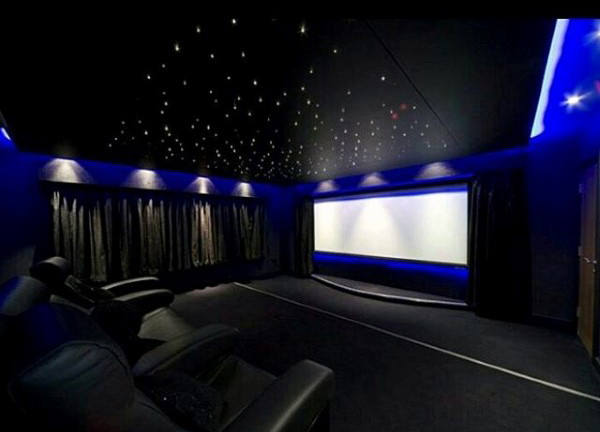 Luxury Home Theater Design With Neon Blue Walls