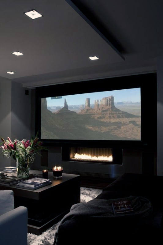 Modern Home Theater Design With Fireplace Under Projector Screen