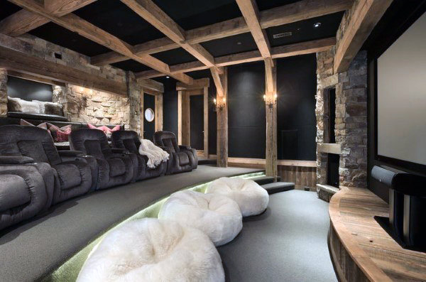 Rustic Home Theater With Wood Beam Ceiling Stone Walls And Recliner Chairs
