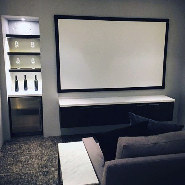 Simplistic Media Room With Small Bar