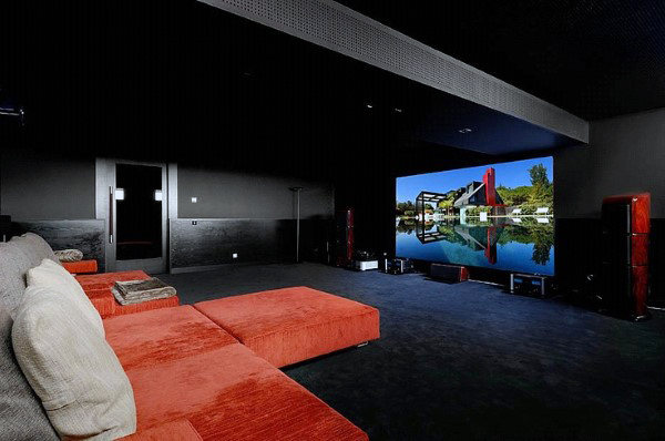 Black Home Theater With Red Couch