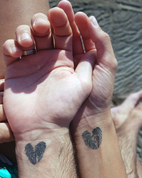 Amazing Couples Tattoos Fingerprint Hearts On Wrist