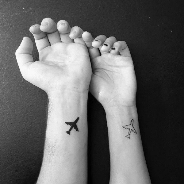 Corresponding Tattoos For Couples Airplanes On Wrist