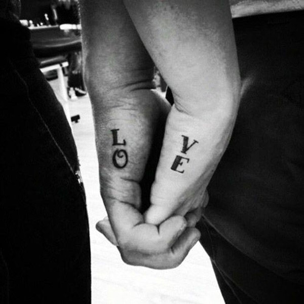 Amazing Couple Tattoos Love Word On Outer Hand