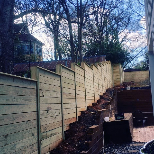 Sloped Hill Backyard Ideas For Wooden Fence